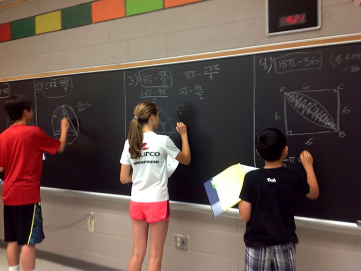 students-solving-problems-on-board.jpg